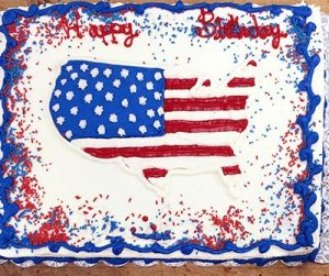 Festive July 4th Cake with the United States filled in with stars and stripes.